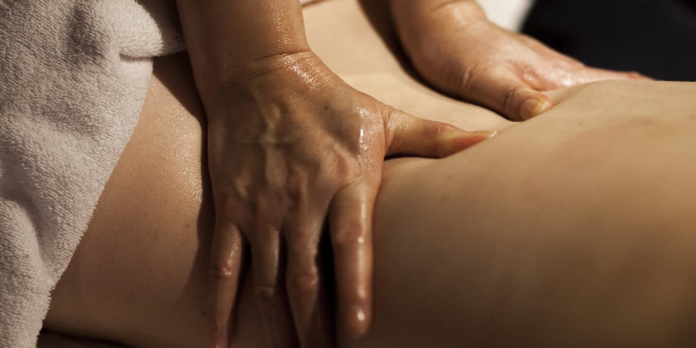 Young woman's back during back massage at the spa.